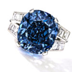 This undated photo provided by Sothebys shows the 9.54 carat blue diamond ring worn for decades by child star-turned-ambassador Shirley Temple, which is going up for auction on April 19, 2016 by Sotheby's in New York. The ring, purchased in 1940 by her father for Temple's 12th birthday for $7,210, now has a pre-sale estimate of between $25 million and $35 million. (Sotheby's via AP)
